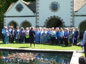 Coastal Voices and Bangor Community Choir singing together by the Pin Mill